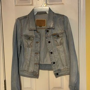 Light distressed denim jacket